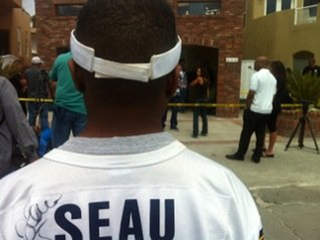 Fans mourn outside Junior Seau's home