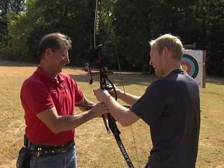 Bulls-eye! Cayden takes aim at Archery