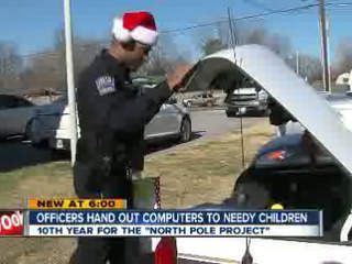 Tulsa area officers play Santa, deliver computers