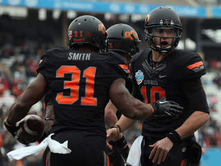 Heart of Dallas Bowl - Purdue v Oklahoma State - Jeremy Smith and Clint Chelf