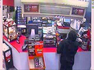 Surveillance video captures robbers firing gun during convenience store robbery
