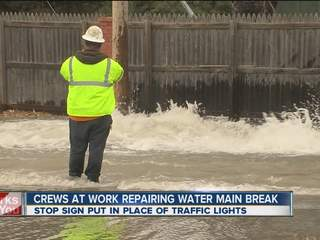 Crews work to fix water main break