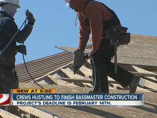 Crews constructing building, ramps, and dock for Bassmaster