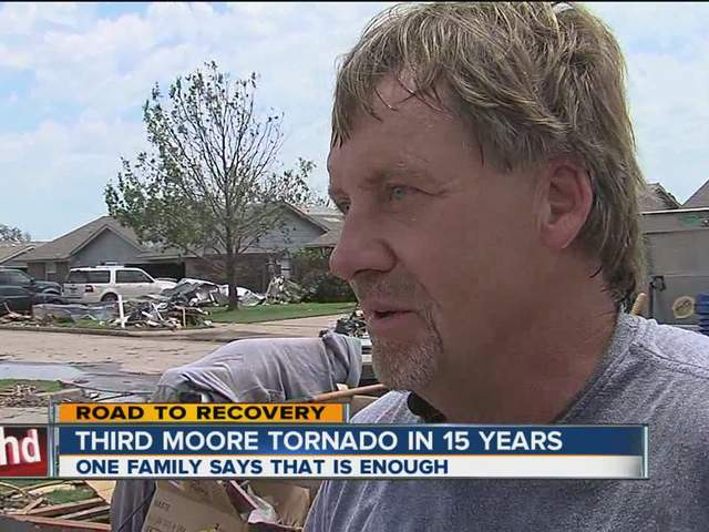 Man leaving Moore after tornado levels home