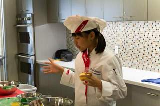Chef Remmi prepares strawberry salsa