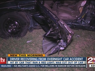 Car runs red light, plows into another vehicle