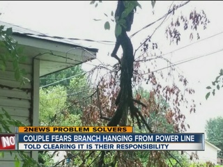 OG&E remove branch from power line for couple