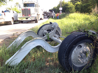 Truck hauling 40K lbs. of concrete overturns