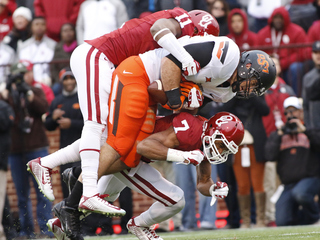 OU, OSU move up in playoff rankings