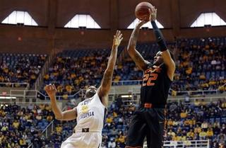 OK State falls to #17 West Virginia, 77-60