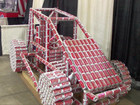 Midget race car made out of empty Budweiser cans