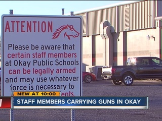 Armed Okla. schools respond to int'l attention