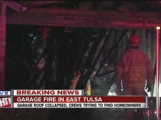 Roof collapses over garage after fire