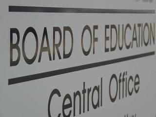 Slain bank president elected to school board