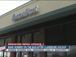 Bank robbery suspect at large in Claremore