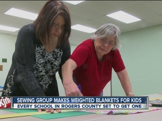 Group sewing weighted blankets for special needs