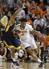 Short-handed OK State falls to West Virginia