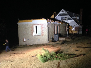 Family hides in basement as tornado damages home