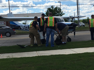 Small plane lands on Memorial Drive near...