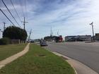 FedEx truck hits power lines, flips over in BA