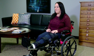 Woman crushed between vehicles files lawsuit