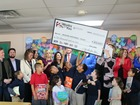 $10,000 check presented to Reading Partners Org.