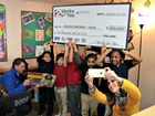 Reading Partners Tulsa receive books and $10,000