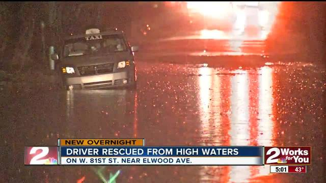 Driver rescued after stranded from high waters in West Tulsa