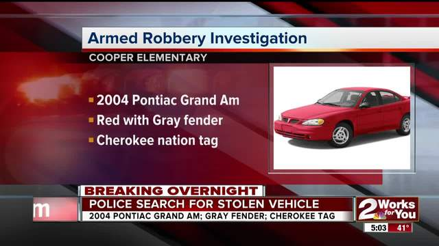 Police search for carjacking suspects and red Pontiac Grand Am