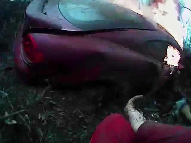 Officer pulls man away from crashed car on fire