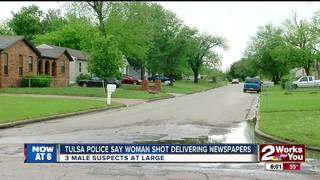 Woman shot while delivering newspapers