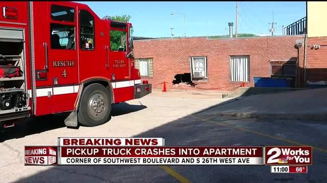 Pickup truck crashes into West Tulsa apartment