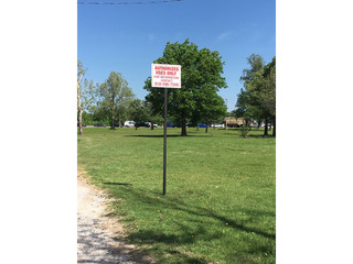 Tulsans outraged over signs put up at park