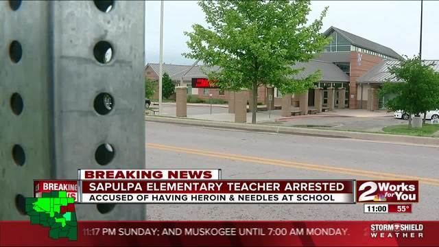 Teacher arrested after heroin found in purse at school