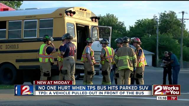Tulsa Public School bus slams into parked car