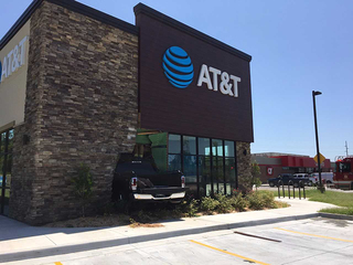 Truck crashes into Tulsa AT&T store