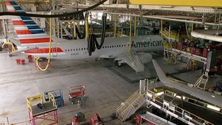 'AvGeeks' land in Tulsa, tour maintenance base
