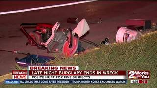 Police search for suspects after burglary, wreck