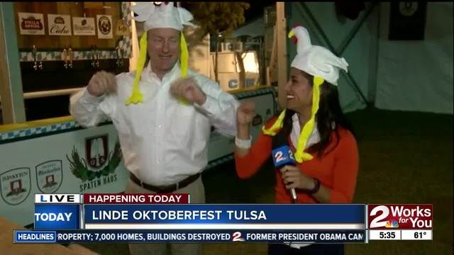 Doing the chicken dance to preview Oktoberfest Tulsa