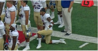 TU football player kneels during Nat. Anthem