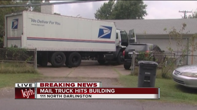 a usps driver lost control of his mail truck and drove into an electrical pole on north darlington before crashing through a fence and coming to a stop in