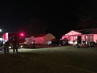Bystander gets family out of house during fire