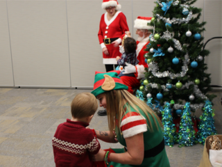 Shriners give gifts to kids at Christmas party