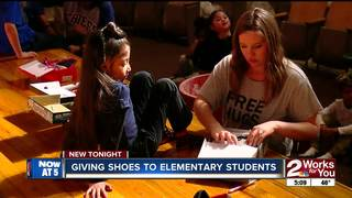 Free shoes given to 600 elementary students