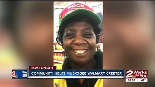 Shoppers helping Walmart greeter with a new car