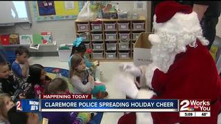 Claremore Police give toys to students