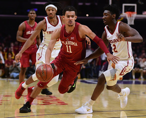 Young sets record with 22 assists in OU win