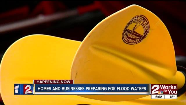 Businesses prepare for flooding from river