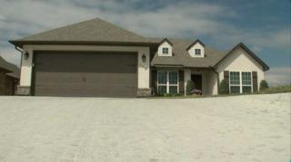 BA woman battles home builder to fix home