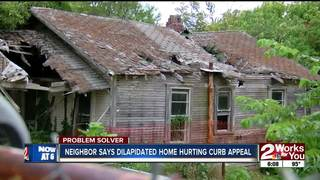 Woman has problem with dilapidated property